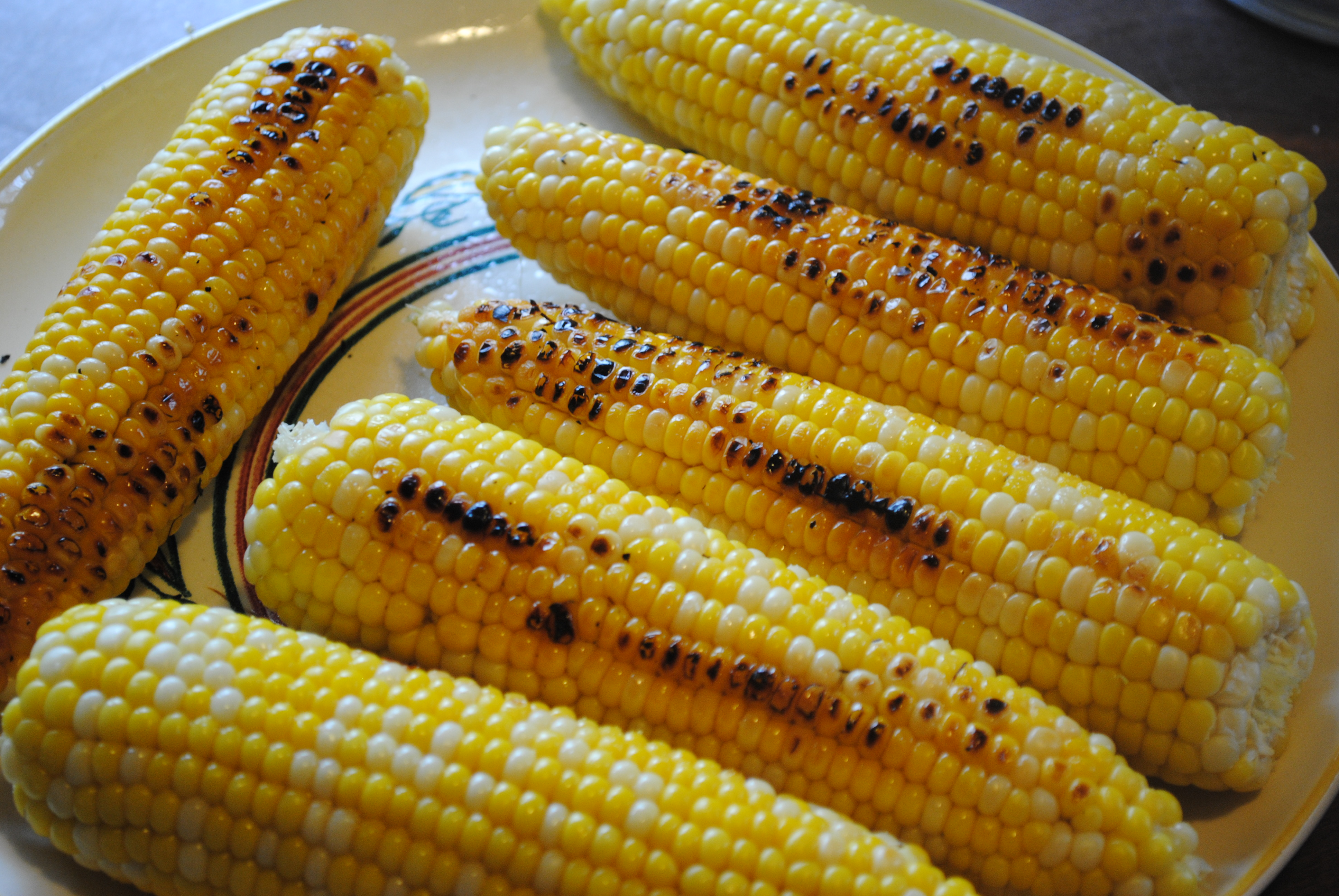 GRILLED CORN ON THE COB IN THE HUSKS