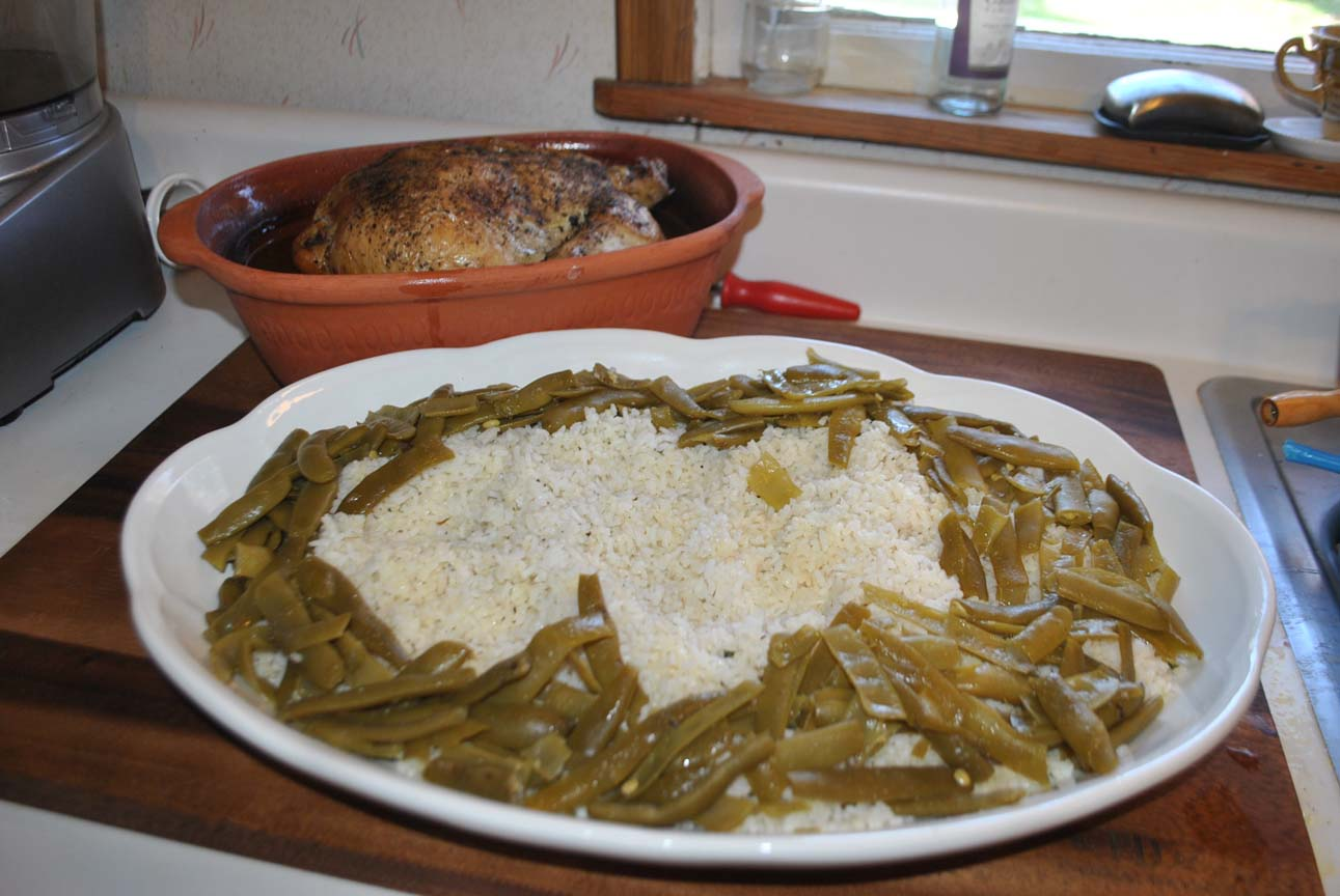 Country Roasted Chicken In A Romertopf Clay Baker With Seasoned Rice And Green Beans